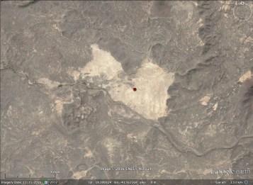 The Wadi Dabsa tufa basin (pale area) i the basalt fglows of the Harrat al Birk (Image: Google Earth)