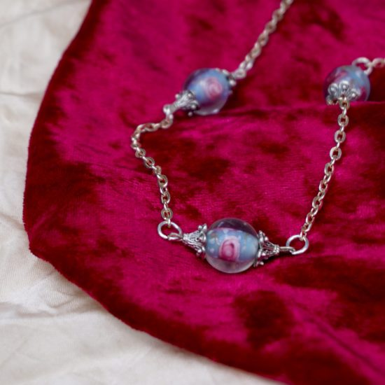 Glass beads on silver chain.
