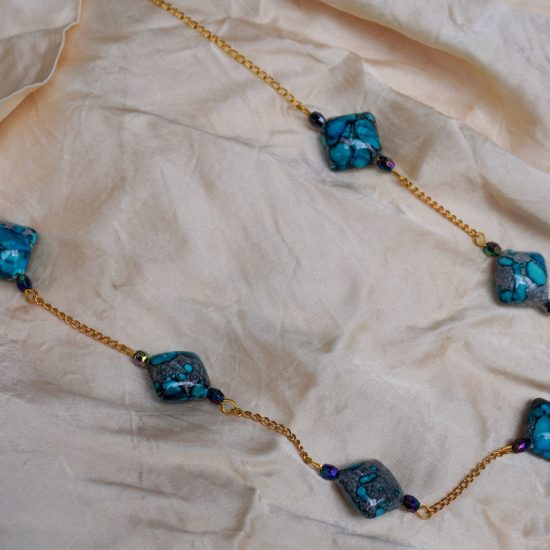 The combination of the blue, purple and gold inspired this necklace.