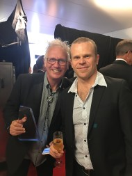 Rusty Thorpe from Byron Bay Bluesfest and Russell Mills from Surfer Rosa celebrate Bluesfest's gold award.
