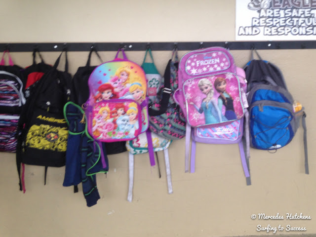 Install backpack bar outside of the classroom to avoid the clutter.