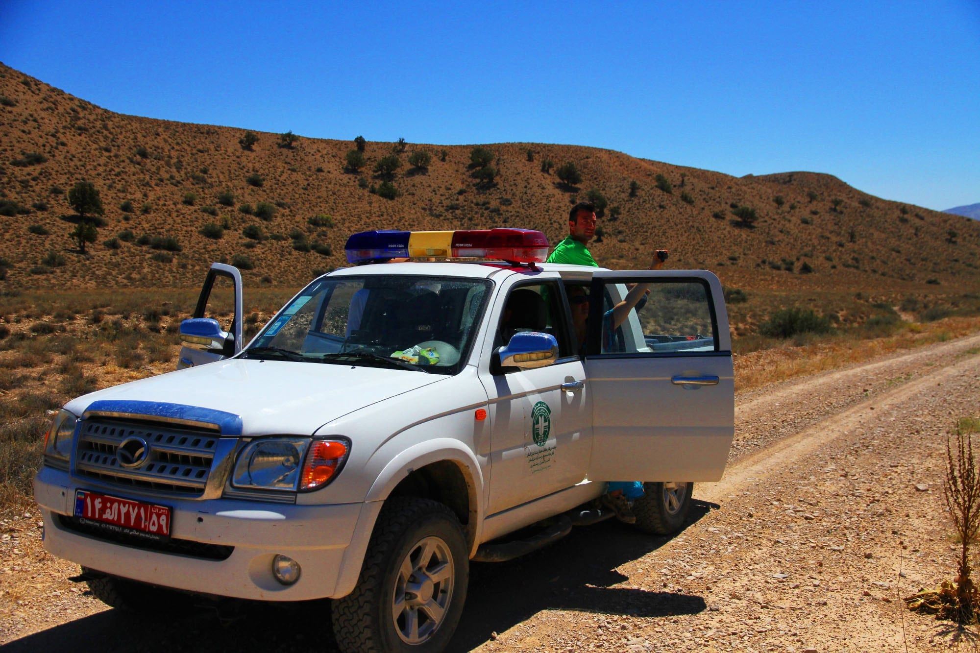 The car of environmental organization transferred our equipment and backpacks to the camp.