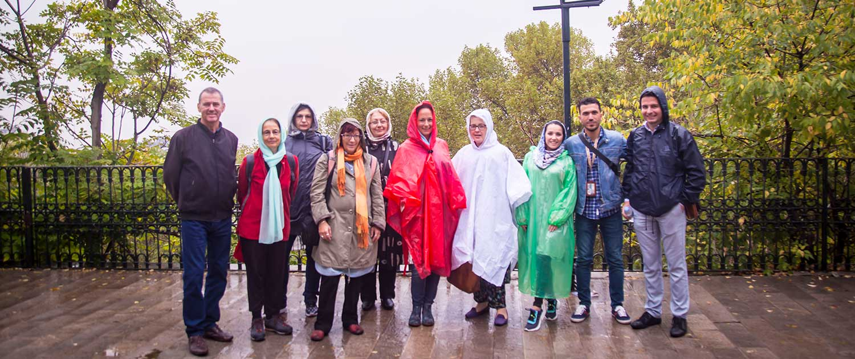 Tourists visiting Tehran on a Rainy Autumn Day.