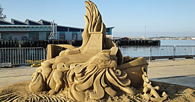 sandcastle by pier