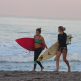 Surf instructors Holly and Chloe showing up in the early morning light.