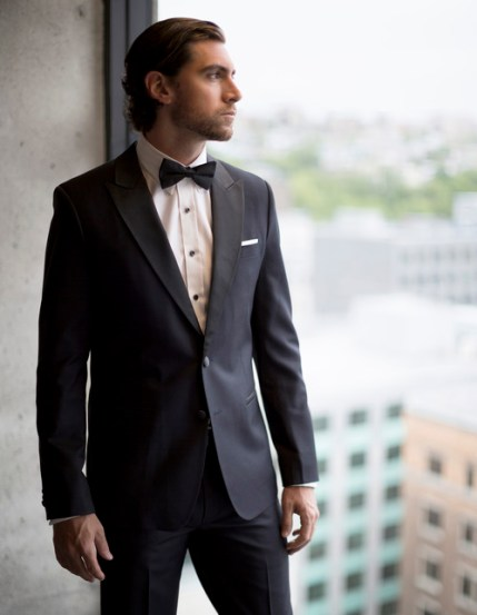 Man with a black tuxedo and a bow tie