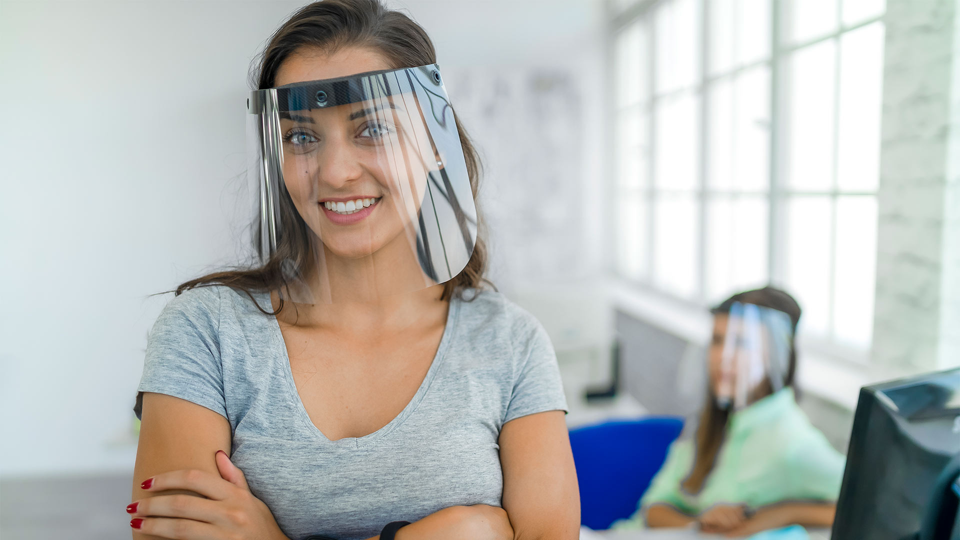 Woman wearing face shield