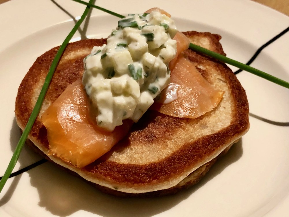 smoked salmon blinis with with an apple sour cream topping