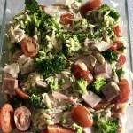 Healthy lukewarm green Greek pasta salad