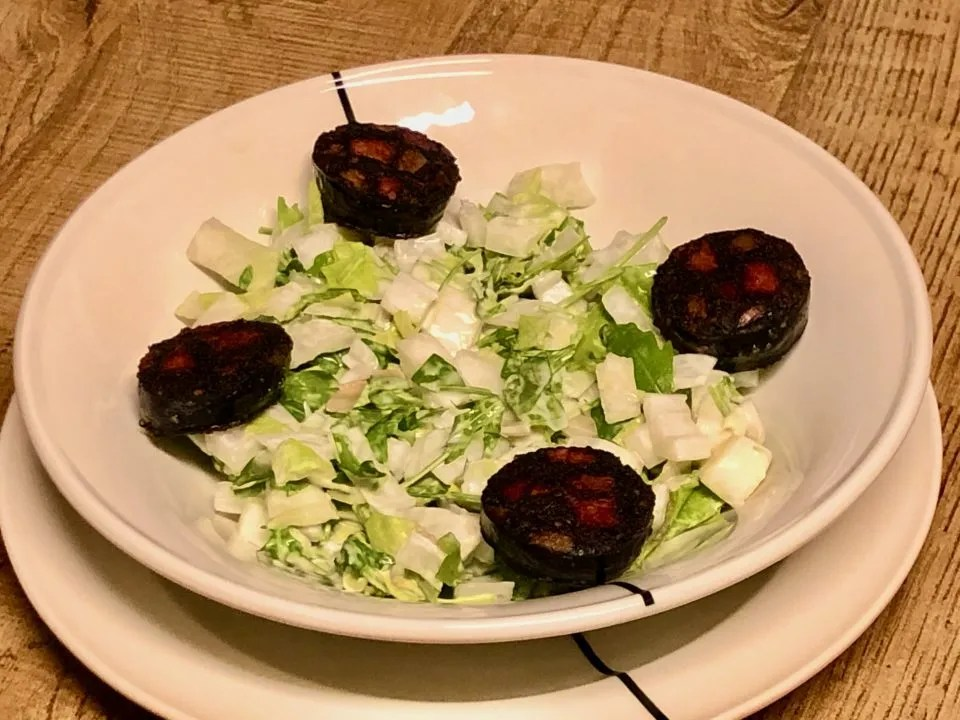Belgian endives and arugula salad with blood sausage