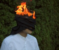 Man with cloth on his head on fire