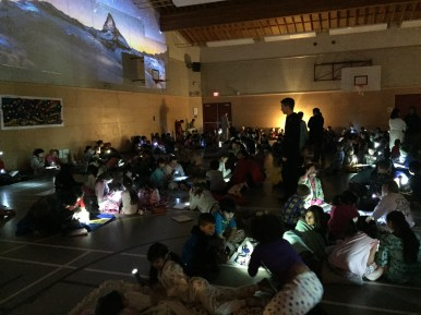 Students were thrilled today because it was time for 'Reading Under the Stars'. Look at the gym - it was magical! Older students read with little buddies and model leadership, patience, and a love of reading.
