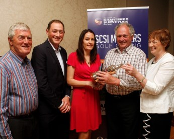 Marie Connolly of APCOA presenting the winning cup to King Auctioneers
