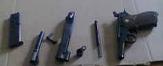 1911 pistol parts ready for cleaning.