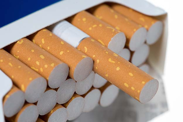 A full pack of cigarettes with one pulled out slightly. | bartering chip