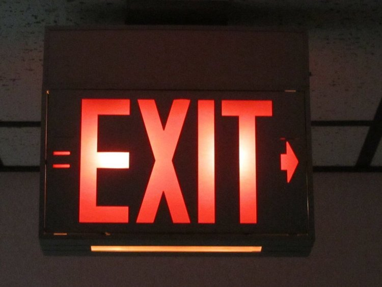 Avoid Holiday Violence store exit sign