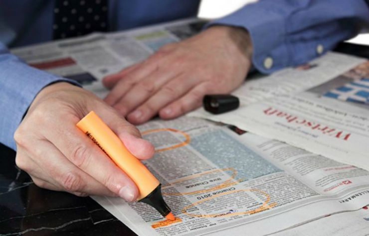 Looking job at the newspaper | Everyday Uses For Your Emergency Survival Kit