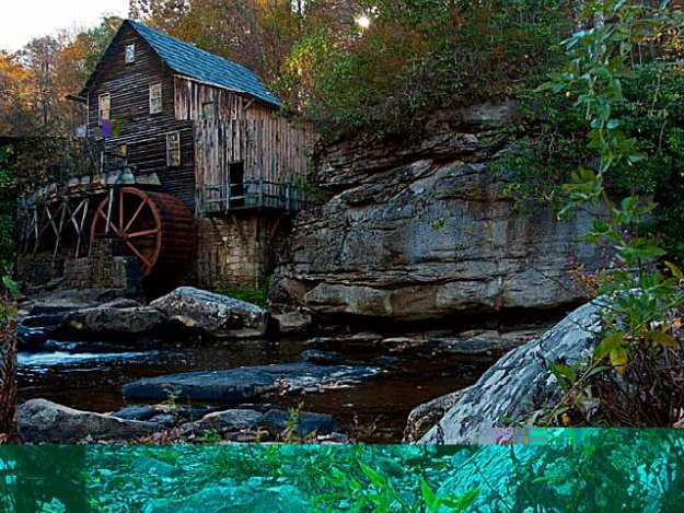 A cabin, water wheel and river in Babcock State Park, West Virginia.