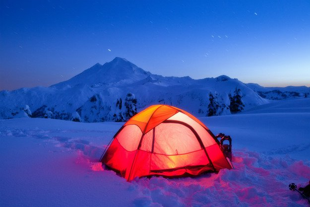 tent-in-snow-at-night