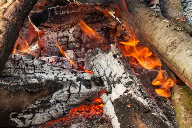 burning-fire-with-large-hot-logs How To Start and Maintain a Fire in a Winter Survival Situation