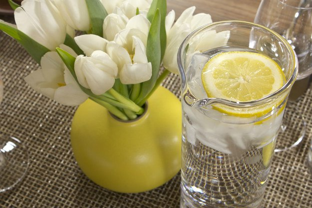 lemon water in glass 12 Health Benefits of Lemon Water | Simply Healthy Living