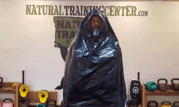 Poncho | Survival Uses For A Contractor's Trash Bag
