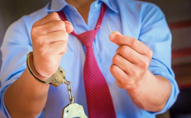 Free the Other Hand   How To Escape Handcuffs Using A Paper Clip   how to pick handcuffs