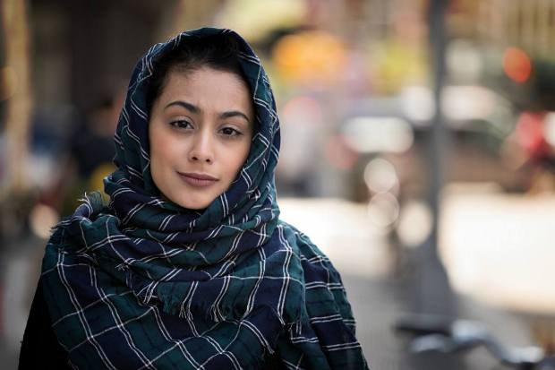 Young woman wearing hijab head scarf in city smile happy face portrait | Travel Safety Tips You Shouldn't Ignore