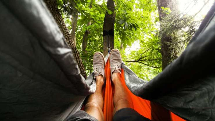 Focus image person feet sitting in the hammock | How To Make A Hammock In The Rainforest And Elsewhere