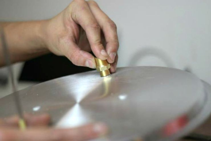 Insert a compression fitting into the lid | How To Make A Moonshine Still