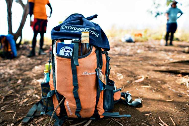 Blue and orange bag in the ground | The Ultimate Bug Out Bag List For Every Survivalist