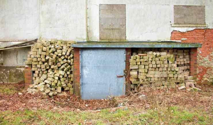 Rusty metal cellar door in garden backyard for security | How To Build Your Own Underground Bunker For Survival
