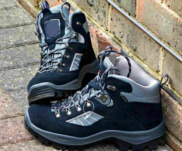 Black and gray hiking boots | Uses for Paracord That Will Surprise You