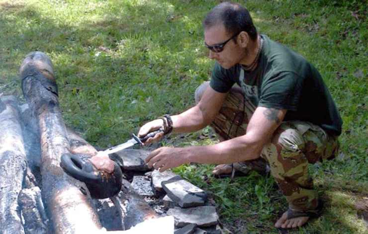 Man cooking using kettlebell   Why The Kettlebell Is The Ultimate Tool For Physical Preparedness