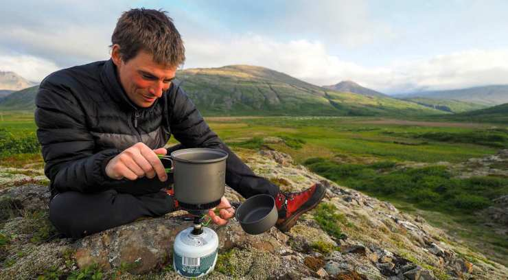 Man boiling water in the mountain | How To Purify Water | Water Decontamination Techniques
