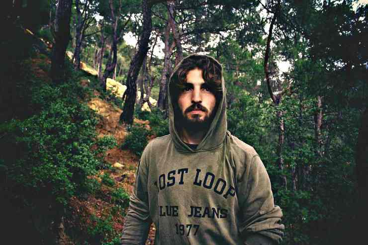 Man wearing hoodie lost in the forest   Steps To Survive Anything