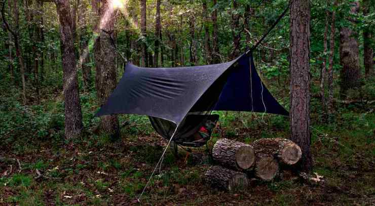 Camping hammock with rain cover at sunrise | How Camping In The Rain Can Prepare You For A Disaster