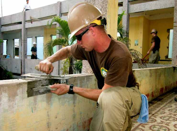 Man working papercrete | For Preppers, Papercrete Is The New Concrete