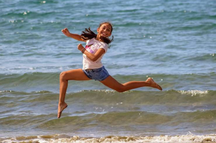 Happy running girl on the beach   Survival Uses For Peppermint Oil