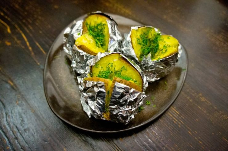 grilled-potatoes-foil-served-on-dark | camping food
