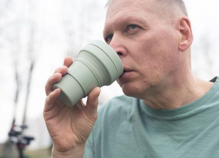 mature-man-holding-eco-reusable-cup | Camping Hacks