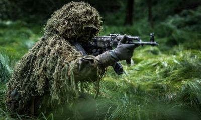 camouflaged commando assault forest soldier dressed | How To Make A Ghillie Suit From Scratch | featured