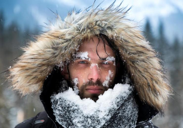 mans face covered snow against backdrop   winter preparation checklist