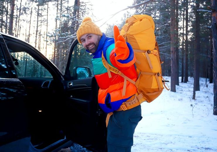happy man winter forest waving hand | essentials needed for living in your car