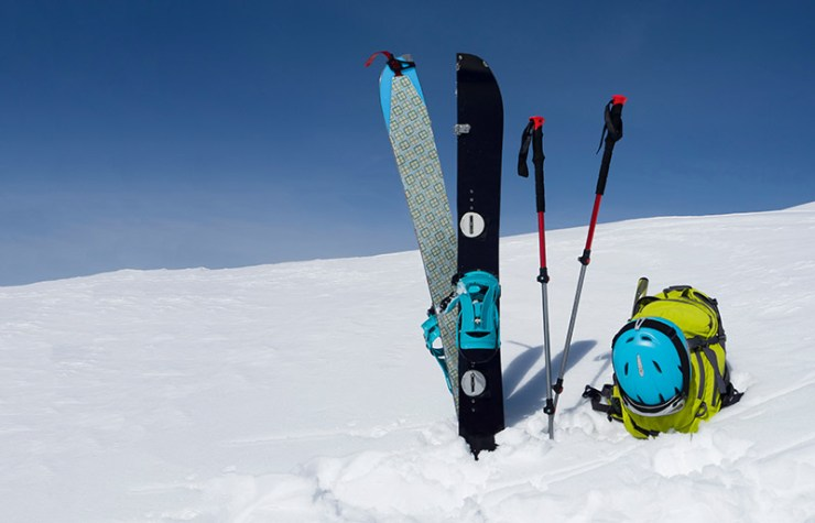 splitboard halves trekking sticks backpack sky | how to prepare for an avalanche