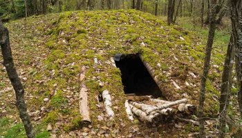 military underground camouflaged by logs | How To Build A Bunker | Featured