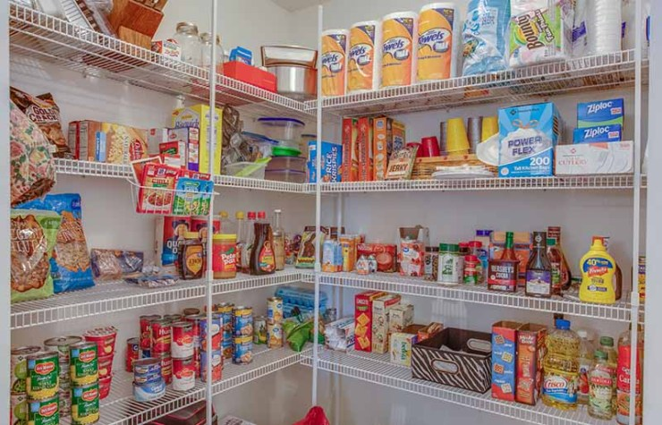pantry shelves with food and stock | how to build a bunker