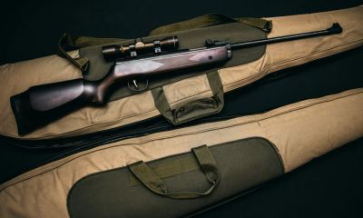 brown and black sniper rifle with beige bag | How To Use A Picture Frame For Hidden Gun Storage | featured