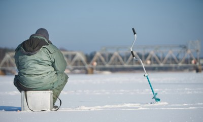 Fisherman enjoying a days fishing on the ice | Ice Fishing 101 | Everything You Need To Know | featured