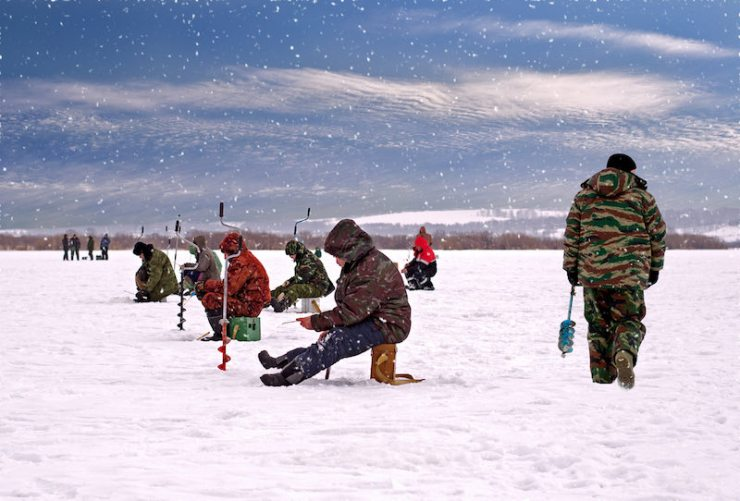 Fishermen on the ice fishing on the river | ice fishing hut